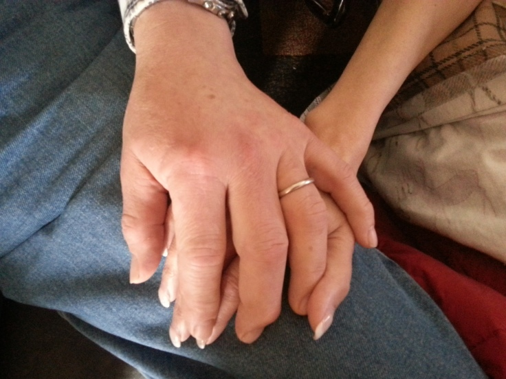 A time we will never forget - Big brother Tom holding Eileen's hand