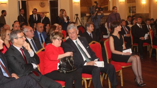 The Ambassador's wife in black.  The Ambassador of Finland in red.