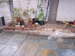 Flagstone yard and brick wall garden