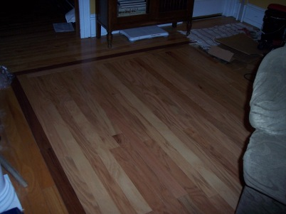 Removal of inlaid carpet and finishing the wood flooring