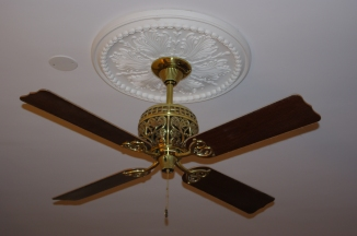 The brass ceiling fan and medallion
