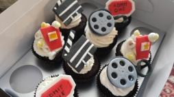 Fondant movie-themed designs on chocolate cupcakes